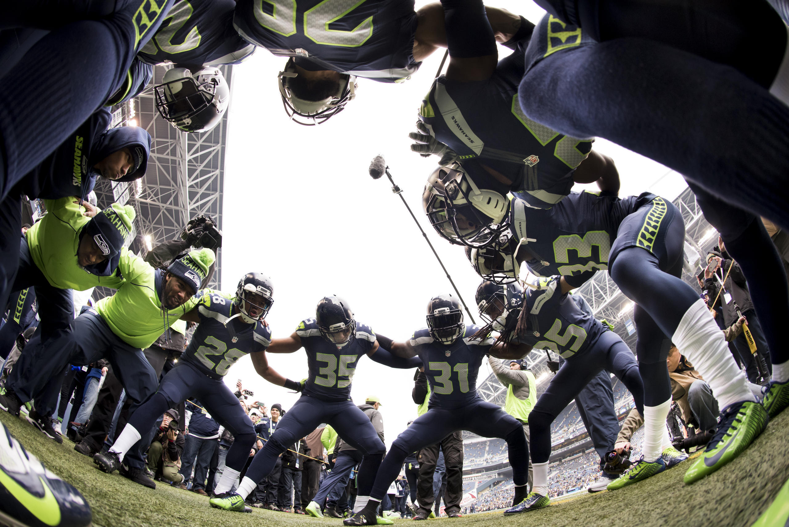 Defensive backs take part of their traditional pregame huddle before taking the field for warmups.