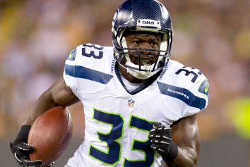 Aug 23, 2013; Green Bay, WI, USA; Seattle Seahawks running back Christine Michael (33) during the game against the Green Bay Packers at Lambeau Field.  Seattle won 17-10.  Mandatory Credit: Jeff Hanisch-USA TODAY Sports
