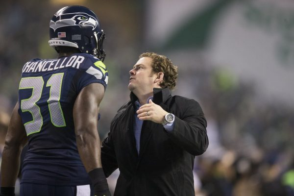 Seahawks general manager John Schneider greet Seahawks safety Kam Chancellor before the Seattle Seahawks take on the Carolina Panthers at CenturyLink Field on Saturday, January 10, 2015.011015 - SEATTLE, WA - (seahawks10)